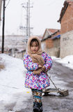 Pull the sled of Chinese female. The northern countryside on the path pulled the sled of the Chinese female Stock Images