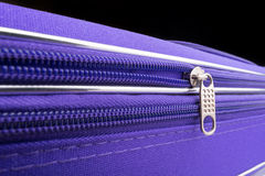 Pull Tab and Chain of a Zipper on a Violet Suitcase Royalty Free Stock Photography