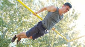 Male Athlet Pull-up Strength Training Exercise. Pull-up strength training exercise. Slim athlete a very fit guy fitness instructor or a personal trainer working stock photos