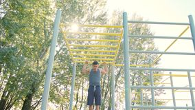 Male Athlet Pull-up Strength Training Exercise. Pull-up strength training exercise. Slim athlete a very fit guy fitness instructor or a personal trainer working royalty free stock photos