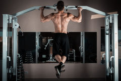 Pull ups. Strong man doing pull ups Royalty Free Stock Images