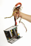 Pulled out. Old broken dusty power supply unit Stock Image