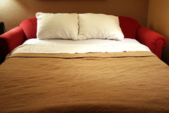 Pulled out sofa bed Stock Photos