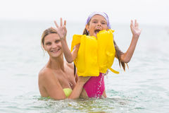 She pulled out of the water his seven-year daughter in the swimming vest Stock Photos