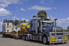 Roadtrains at a Truck-bay resting, and Checking tires, on the North West Highway. stock photo