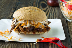 Pulled pork barbecue sandwich with cole slaw. Pulled pork barbecue sandwich with whole wheat buns and cole slaw Royalty Free Stock Photography
