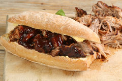 Pulled pork with barbecue sauce. On a crusty bread roll stock image