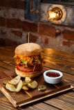 Pulled pork BBQ burger with tomatoes and jalapeno selected focus. Pulled pork BBQ burger with tomatoes and jalapeno, selected focus royalty free stock photography