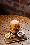 Pulled pork BBQ burger with tomatoes and jalapeno selected focus. Pulled pork BBQ burger with tomatoes and jalapeno, selected focus stock image