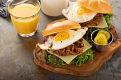 Pulled pork breakfast sandwiches with fried egg. Cheese and lettuce stock photography