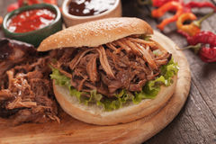 Pulled pork burger. American pulled pork burger sandwich with bbq sauce Royalty Free Stock Images