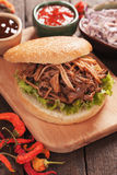 Pulled pork burger. American pulled pork burger sandwich with lettuce and dipping sauces Royalty Free Stock Photography