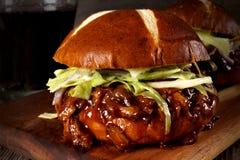 Pulled pork burger close up on wood server Royalty Free Stock Photos