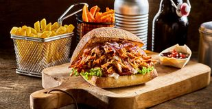 Pulled pork burger with french fries royalty free stock images