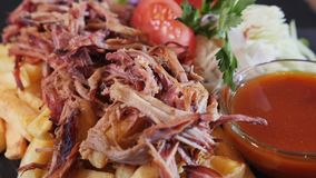 Pulled pork fast food menu with appetizing french fries. Pulled pork fast food menu with delicious meat served along appetizing french fries, vegetable garnish stock video