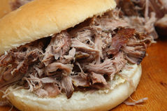 Pulled Pork  or Hog Roast Roll. Pulled pork in a soft white bread roll Royalty Free Stock Photos