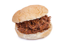 Pulled Pork Sandwich. Barbequed pulled pork sandwich isolated on a white background Royalty Free Stock Images