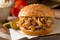Pulled Pork Sandwich. A delicious slow roasted pulled pork sandwich on a Texas style bun Royalty Free Stock Images