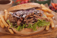 Pulled pork sandwich. With lettuce and coleslaw salad Royalty Free Stock Photography