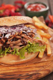 Pulled pork sandwich. With lettuce and coleslaw salad Royalty Free Stock Photos