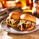 Pulled pork sandwiches with bbq sauce and slaw. Close up photo of two pulled pork sandwiches with bbq sauce and slaw Royalty Free Stock Images
