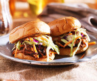 Pulled pork sandwiches with bbq sauce and slaw. Photo of two pulled pork sandwiches with bbq sauce and slaw Stock Image