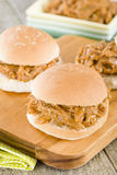 Pulled Pork Slider. Juicy slow roasted pork meat in a white bun Stock Photography