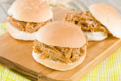 Pulled Pork Slider. Juicy slow roasted pork meat in a white bun Royalty Free Stock Photos