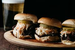 Pulled pork sliders on a wooden plate Stock Photo