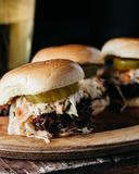 Pulled pork sliders on a wooden plate Royalty Free Stock Images