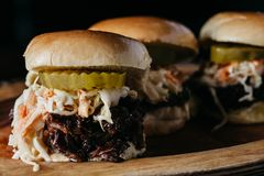 Pulled pork sliders on a wooden plate Royalty Free Stock Image