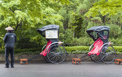 Pulled rickshaw waiting for tourists at Torokko Arashiyama Station. Kyoto, Japan - March 2016: Pulled rickshaw waiting for tourists at Torokko Arashiyama Station Stock Photo