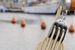 Pulley. With rope on a sailboat with buoys in background Royalty Free Stock Photo