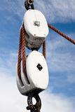 Pulley block. Wooden pulley block and rope aganst a blue sky Stock Images