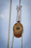 Pulley Block 02. Wooden pulley block with pin cap and white running line Stock Images
