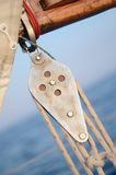 Pulley Blocks of mainsheet, running rigging of vintage yacht Stock Photos