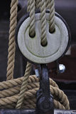 Pulley with ecru rope Royalty Free Stock Images