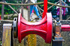 Pulley red metal with rust Royalty Free Stock Photo