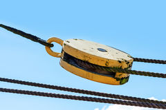 Pulley with ropes against the blue summer sky Royalty Free Stock Images