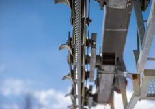 Pulley wheels on a ski chairlift tower royalty free stock photos