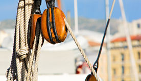 Pulley. Wooden pulley equipping an old sailboat Royalty Free Stock Images