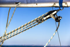 Pulley at the yacht boom. Close-up of pulley with rope at the yacht boom Royalty Free Stock Photo