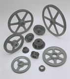Pulleys and Bushings. 1530A-1CT Five metal pulleys and six metal bushings on white bacground Stock Images