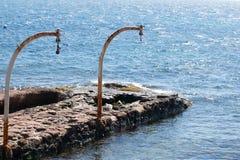Pulleys przy morzem Obrazy Royalty Free