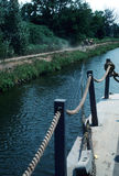 Pulling it along. A horse pulls a boat through a canal Royalty Free Stock Images