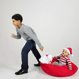 Pulling Baby for Christmas royalty free stock photography