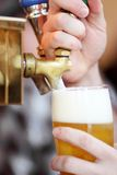Pulling a beer tap Stock Photos