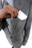 Pulling card out of pocket Stock Photography