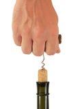 Pulling corkscrew cork from the bottle Stock Image