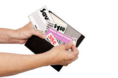 Pulling Coupons Out of Wallet. Woman's hands taking coupons from wallet.  Isolated on white with copy space Stock Images